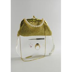 Ted Noten     Icepick Bag    19°—16°—9cm  icepick, gold ring, synthetic diamonds, cocaine, textile, cultivated pearls