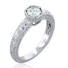 Another intricately detailed masterpiece from the Novelique Collection by YAEL DESIGNS -- an 18k white gold engagement ring featuring a 0.5 carat diamond, accented with 0.13 carats of brilliant cut diamonds. Item # 09353. #BARONS #baronsjewelers #YaelDesigns #engagement #novelique #diamondring