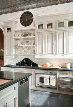 So much to love in designer Betty Lou Phillips' own kitchen: The tin ceiling, gorgeous cabinetry, the camel-back splash detail at the sink, and more. - via Cote de Texas Country Kitchen, New Kitchen, Kitchen Dining, Kitchen Decor, Kitchen Sink, Kitchen Backsplash, Kitchen Ideas, Subway Backsplash, Backsplash Design