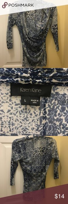 NWOT Karen Kane sheer quarter length sleeve blouse NWOT sheer stretchy quarter-length blouse with a wrap around detail.  This stretches and looks great with a silk tank underneath.  100% Nylon Karen Kane Tops Blouses