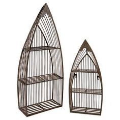 """Set of two wrought iron nesting bookcases with boat silhouettes. Each bookcase has three shelves.Product: Small and large boat bookcaseConstruction Material: Wrought ironColor: Natural Dimensions: Small: 23.5"""" H x 10.5"""" W x 4"""" D     Large: 33"""" H x 13.25"""" W x 6.25"""" D"""