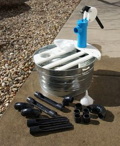 Pump Kit - Kids love to play with water! Hand pump with galvanized steel tub, protective guards to keep kids safe, and a collection of tubes and fittings to make endless configurations for the water to flow through. Pump back into the bucket, or over to your garden!