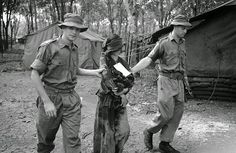 A Vietnamese girl, 23 years old, was captured by an Australian patrol 30 feet below ground at the end of a maze of tunnels some 10 miles west of the headquarters of the Australian task force (40 miles southeast of Saigon). The woman was crouched over a World War II radio set. About seven male Viet Cong took off when the Australians appeared—but the woman remained and appeared to be trying to conceal the radio set. She was taken back to the Australian headquarters where she told under sharp…