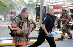so sad--FIRE TRAGEDY--Evansville firefighter Chris Wagener and an Evansville police officer rush Aallyah Frazier, 4, who was trapped on the second floor of a burning apartment building, to an ambulance on Tuesday, Sept 6, 2011. The girl was breathing but unconscious as the firefighter carried her out. Her sister and mother, Kristyn Frazier, 24, were pulled out and given CPR before transport. The girls were listed in critical but stable condition at an area hospital. Their mother later died.