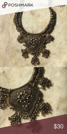 Gold Coin Medallion Statement Necklace Greetings from paradise-perfect style! Make your escape with a head-turning statement-maker that showcases your style. Wear this ultra-chic piece over a simple  dress for the perfect pop of uniqueness & sparkle. antique brass lobster clasp Janis Marie  Jewelry Necklaces