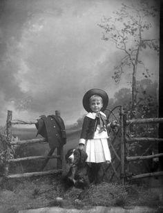 Florida Memory - Boy and dog at the gate