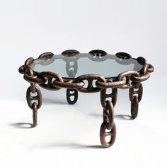 Antique solid iron ship chain repurposed into an interesting coffee table with inset glass. $1800