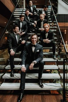 Groomsmen sitting on stairs posing