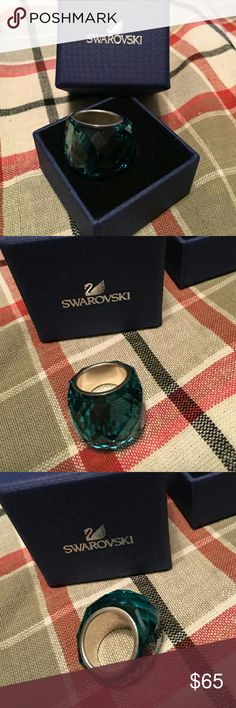 NWT Swarovski Lazo Blue Nirvana ring size 52 or 6 NWT Swarovski Lazo Blue Nirvana ring size 52 or 6. Never worn! Discontinued style.  Comes with box and gift bag from Swarovski.  Final price. No trades. Swarovski Jewelry Rings