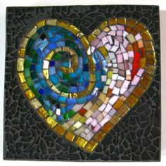 """""""Cardiac Phrenology"""" by Juanita Canzoneri--sculpted base, stained glass, metal-leafed glass, tempered glass, and grout."""