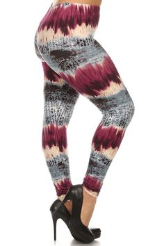 Greet Summer with bold and playful style in our Magenta Tie Dye Plus Size Leggings. They feature gray and beige hues vibrantly contrasted by a pop of deep magenta that gives them their sassy eye-catching style. Compliment this leg fashion piece with chunky silver jewelry and a black button down tank that can easily take you from casual chic daytime style to a dressy dinner ensemble.