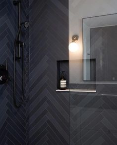 The epitome of bold and luxe design, black tiles are the perfect solution to inject a dose of glamour and moody character to your space. Ready to step into the dark side? Product — Mutina Mews INK | Design by @shaunawaltondesign |Photo by @kierandarcyphoto Herringbone Wall Tile, Black Tiles, Stone Tiles, Wall Tiles, Your Space, Wall Lights, Flooring, Mirror, Lighting