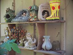 More great ideas for garden art - this is an eclectic mix of vintage ceramic pieces, on display outdoors on an antique wooden shelf My Secret Garden, Wooden Shelves, Vintage Ceramic, Garden Art, Shelf, Outdoors, Display, Ceramics, Antiques