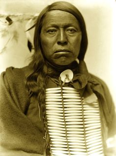 Chief Flying Hawk was a warrior. He fought along with his cousin Crazy Horse, his brothers Kicking Bear and Black Fox at the Little Big Horn. He was present at the death of Crazy Horse and the Wounded Knee Massacre. To escape the constraints and poverty of reservation life he joined Buffalo Bills Wild West Show, 1898. Imitating battle scenes angered him at first. Eventually he sold his picture postcards for a penny to supplement his meager income. When Iron Tail died he became head Chief.