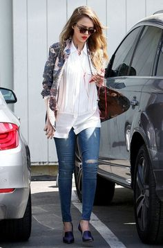 Rocking a daytime red lip on March 21st Jessica Alba makes her way to an office in Santa Monica in a floral print blazer, jeans and purple Elizabeth and James shoes. [Photo Credit: AKM-GSI]