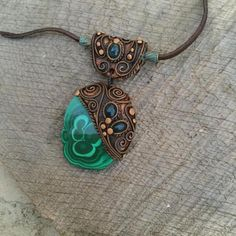 Lovely malachite stalactite slice andblue Kyanite pendant pls see all the photos for better understanding of the size. It comes with adjustable suede or cotton cord - your choice. Good to know: The setting is made out of durable clay - but not unbreakable. I suggest that you wear it
