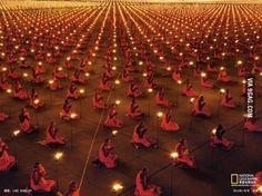 1000s Upon 1000s of Buddhist Monks Kneeling In Meditation