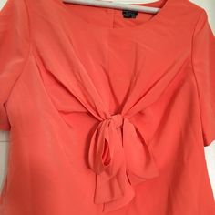 Apricot Bow Top From Anthropologie sz 12 Adorable bow tie front shirt from Anthropologie! Buttons up the back but has a side zipper to make getting on easy! Marked a size 12 but would fit a 14 no problem!!! The bow unties if you are on busty side! This a very pretty top on! Anthropologie Tops Blouses