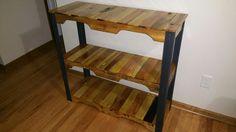 Pallet and angle iron shelf unit.