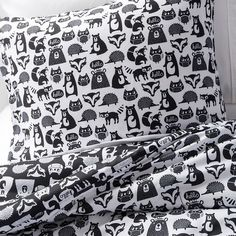 """Woodland creatures gather on the Forest Friends Comforter Set in Black & White from Pillowfort. This kids' bedding set with comforter and 2 pillow shams works well for a boy's or a girl's room. The print on the comforter set has sweet owls, foxes, and bears plus a cheery """"Hello""""."""