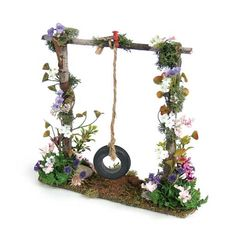 Swing....use a real swing and have climbing plants crawling up the chains.....just a thought