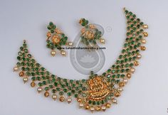 Unique combination of emeralds and lakshmi design in flexible netted style from Swarna Sri Jewellers is a show stealer.Paired with lakshmi emerald earrings. Emerald Earrings, Emerald Jewelry, Ruby Necklace, Gold Jewelry, Diamond Jewellery, Ruby Earrings, Pearl Necklaces, Pearl Choker, Diamond Necklaces