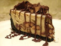 Ruggles Reese's Peanut Butter Cup Cheesecake- used miniature pb cups in batter. Decorated with some of the crushed Oreos & peanuts on top, then put 1/2 pieces of pb cups around the edge and finally drizzled fudge on the top.