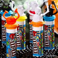 Get their fingers to do the monster mash with candy favors! Pop Halloween finger puppets onto tubes of mini M&M's® for a fun favor and treat. Little ghouls and goblins will love wearing the Halloween characters while munching on yummy milk chocolate. Display your too-cute-to-spook M&M's favors on a boo-tiful plate of mini gumballs – sweet! Halloween Sweets, Halloween Favors, Holidays Halloween, Halloween Kids, Halloween Themes, Halloween Party, Halloween Decorations, School Holidays, Halloween Stuff