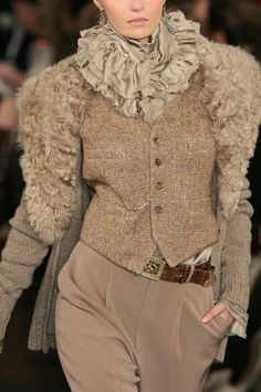 Ralph Lauren.  I'm thinking ruched sweater sleeves attached to a vest or altered jacket. I like the look. No real fur! myb