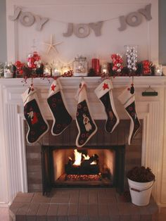 Unique Displays - 20 Glowing Holiday Mantels on HGTV