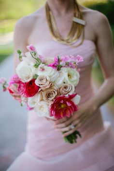 red, white, and pink wedding bouquet // photo by KallimaPhotography.com