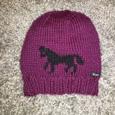 Knitted hat with horse
