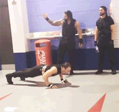 The Shield waiting to go out for Their Match. Dean Ambrose doing Press-ups Roman Reigns Dean Ambrose, Wwe Dean Ambrose, Wwe Gifs, Wwe Funny, The Shield Wwe, I Just Dont Care, Cm Punk, Seth Rollins, Wwe Wrestlers