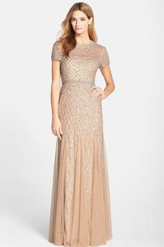 Chiffon and Sequin Crewneck Gown - 7 Gorgeous Mother of the Bride Dresses - Southernliving. Weddings call for romance, and this ethereal dress delivers just the right vibe. Buy It: Adrianna Papell Beaded Mesh Gown, $318