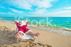 Santa Claus relax in chaise longue on sea beach royalty-free stock photo