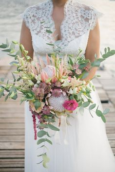 bouquets with pink and green - photo by Irene Fucci http://ruffledblog.com/lake-como-destination-wedding-with-hanging-amaranthus