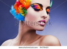 Google Image Result for http://image.shutterstock.com/display_pic_with_logo/575725/575725,1316213126,3/stock-photo-beautiful-young-female-face-with-bright-fashion-multicolored-make-up-feathers-84778423.jpg