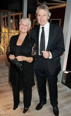 Black Silk from head to toe. VERY IMPORTANT Sheer sleeves with lace accents help narrow the silhouette.  Wonderful: Dame Judi Dench has spoken about her relationship with David Mills on The Times...