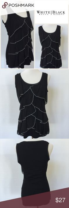 """WHBM Black Sleeveless Blouse EUC.  Flattering layers to front with silvery gray trim to edge of layers.  Raw edges to neckline and arms.  Measurements are as follows and approximate, taken while garment was laying flat.  Underarm to underarm:  17"""".  Shoulder to hem:  26"""".  Logo is internet stock photo.  All other photos are of actual blouse. White House Black Market Tops"""
