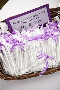 Individual bubble wands/small tubes filled with bubble solution with a sign saying to take one and Blow Us a Kiss When We Come Back As Mr. More #WeddingFavorIdeas
