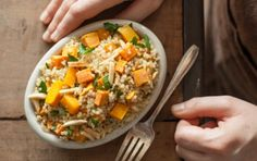 1 cup 1/2-inch cubes peeled butternut squash 1 cup 1/2-inch cubes peeled sweet potato 1 tablespoon onion granules 1/4 teaspoon fine sea salt 1/4 teaspoon ground black pepper 3/4 cup quinoa, rinsed and drained 1 1/2 cup low-sodium vegetable broth 1/2 cup slivered almonds, toasted 1/4 cup chopped fresh parsley Juice of 1 lemon (about 2 tablespoons)