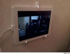 3 Command hooks make an excellent ipad screen holder