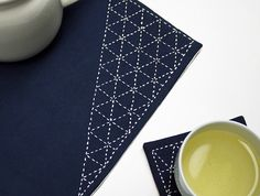 Learn how to do cool Japanese Sashiko stitching and make a beautiful place mat and coaster set in the process!