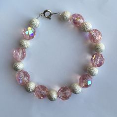 Beautiful handmade jewelry! Silver and iridescent pink beaded bracelet. Silver wiring and clasp. Jewelry Bracelets
