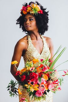 Bride in Gold Wedding Dress with Bright Flower Crown and Bouquet | Brides.com