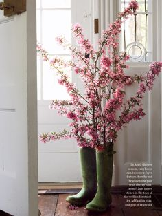 Doesn't the explosion of  pink cherry branches make a perfect fit in these old boots. Fill boot bottoms with stones and then water, Voila!