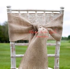 Vintage hessian chair sash by Fuschia on shabby chic style chair. The perfect touch for a vintage / rustic style wedding.