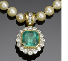 Pearl necklace with an emerald and diamond pendant