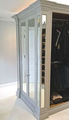 Sterlingdale's bespoke dressing room with built in wardrobes, mirrored columns, and open framed cabinets to expose the oak inside. The doors are either raise and field panel doors or bevelled edge mirrored doors