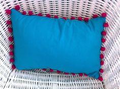 Small brightly coloured cushion with pompom trim. £8.99, via Etsy.